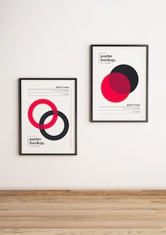 Two framed poster template mockup hanged on wall