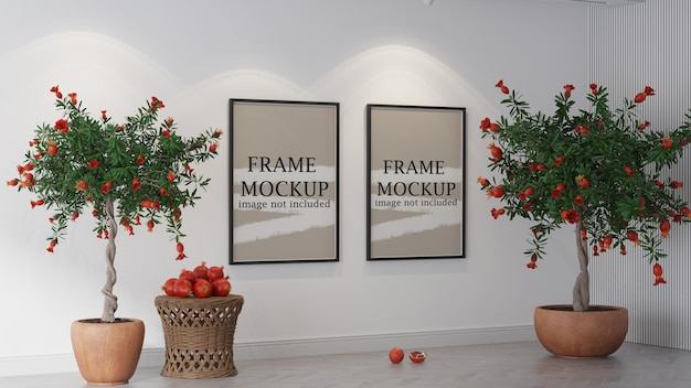 Two frames mockup between small pomegranate plants