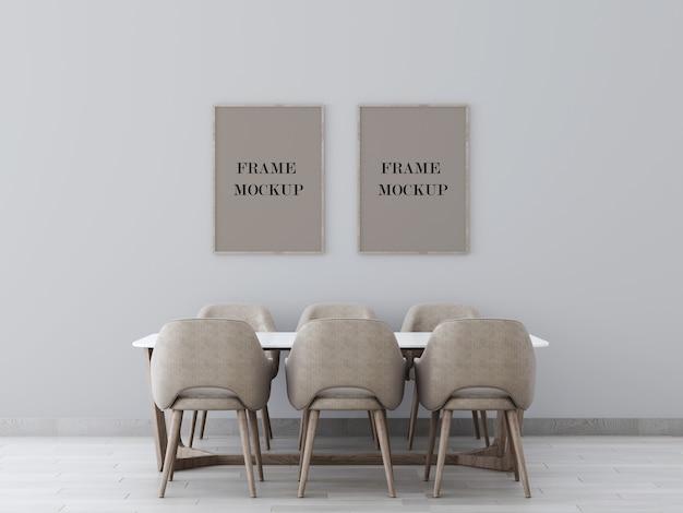 テーブル3dレンダリングモックアップの上の灰色の壁に2つのフレーム