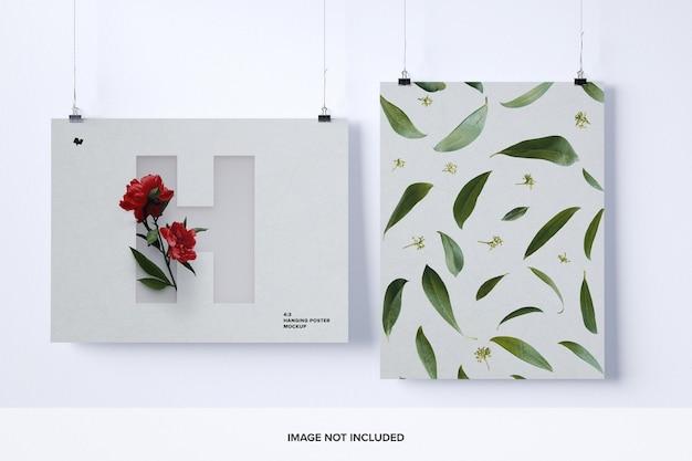 2つの掛かるポスターモックアップ風景とポートレートビュー