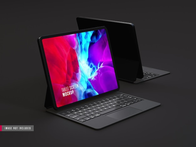 Два изолированных темных планшета про макет с клавиатурой