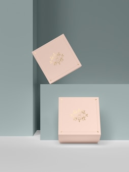 Two pink jewelry boxes with golden symbols