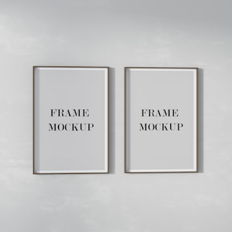Two poster frames mockup on the wall