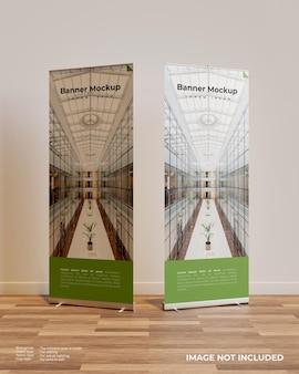 Два свернутых макета баннера в интерьере