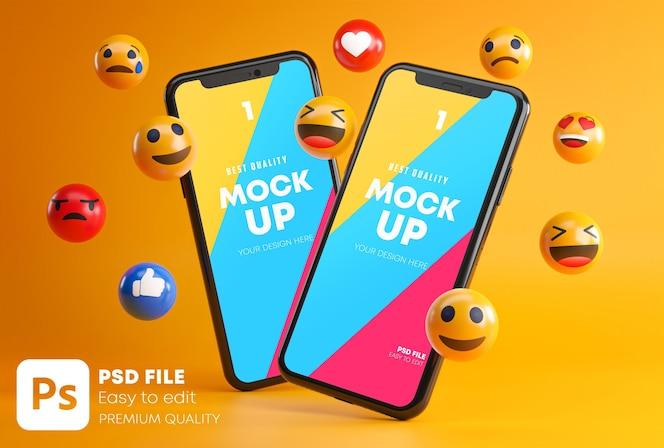 Two smartphones between emojis