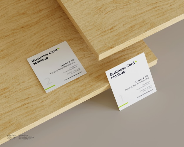 Two square business cards mockup one on above wood and one under