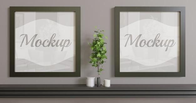 Две квадратные рамки макета на стене. пара черная рамка макет для логотипа, фото и иллюстрации