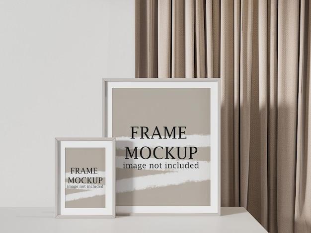 Макет двух рамок для картин перед занавеской