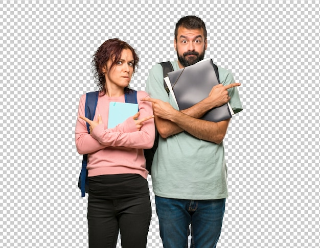 Two students with backpacks and books pointing to the laterals having doubts