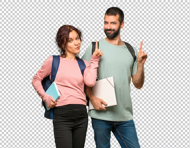 Two students with backpacks and books showing and lifting a finger in sign of the best