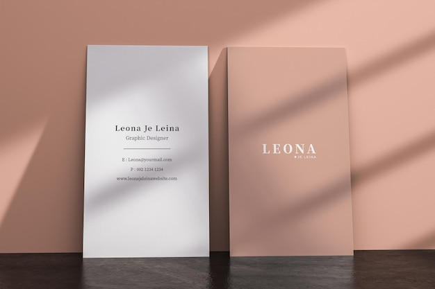 Two vertical business card mockup with shadow overlay