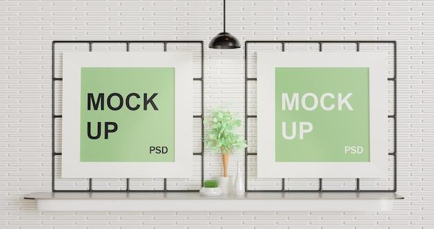 Два макета с белой рамкой на стене