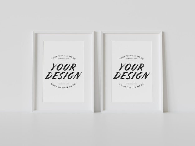 Two white frames leaning on floor mockup