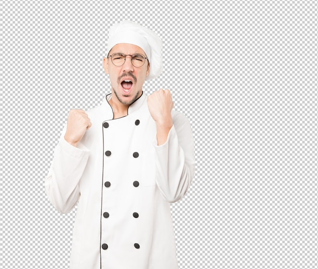 Upset young chef doing a competitive gesture