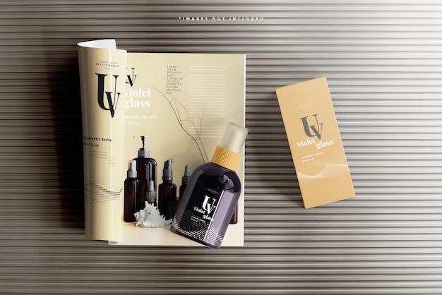 Uv glass cosmetic spray bottle with magazine mockup