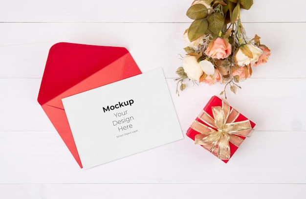 Valentine day greeting card mockup and letter and flower on wooden table