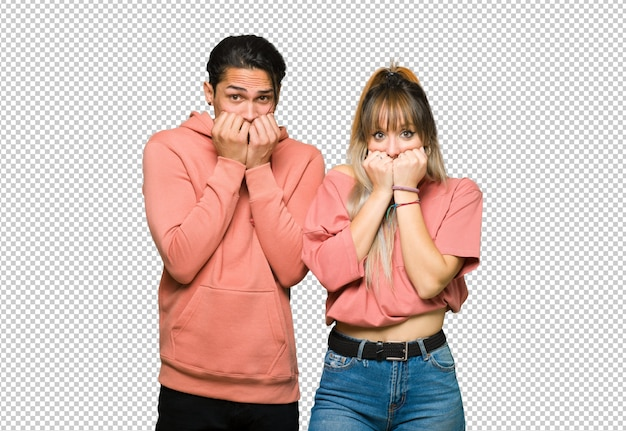 In valentine day young couple is a little bit nervous and scared putting hands to mouth