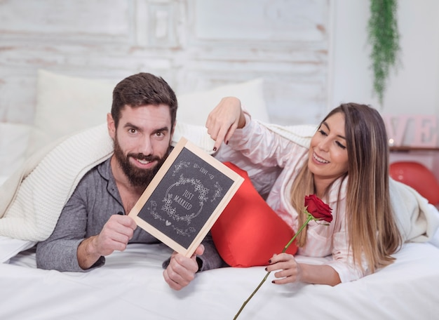 Valentine mockup with couple in bed showing slate