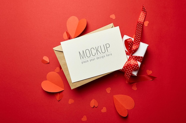 Valentine's day card mockup with envelope, gift box and red paper hearts
