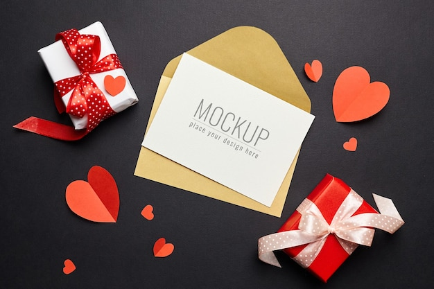 Valentine's day card mockup with envelope, red hearts and gift boxes paper