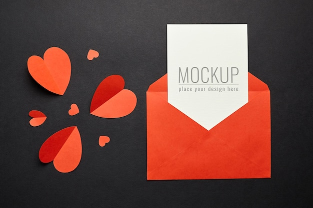 Valentine's day card mockup with red envelope and hearts paper
