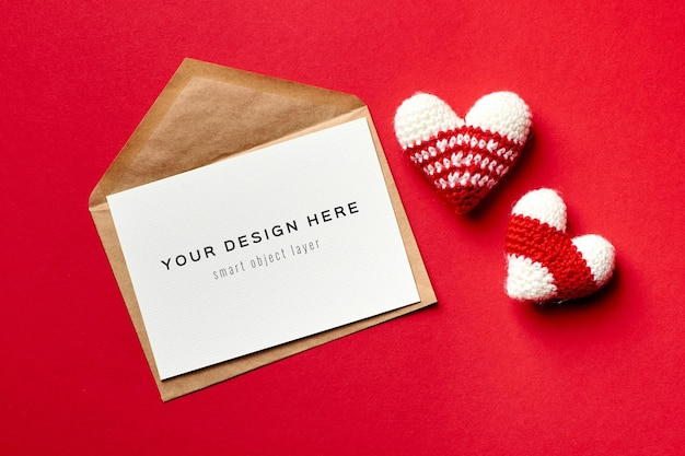 Valentines day card mockup with envelope and knitted hearts