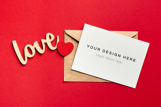 Valentines day card mockup with envelope and wooden decorations
