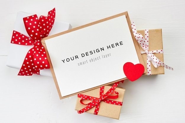 Valentines day card mockup with red heart and gift boxes on white background