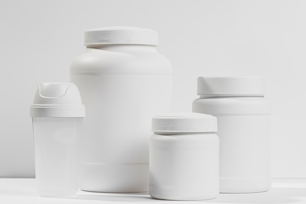 Various white containers with protein powder