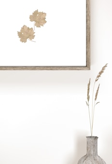 Vase with flowers and wall frame with leaves