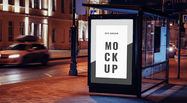 Vertical billboard mockup at bus stop on the night city