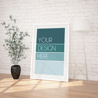 Vertical framed poster mockup in modern interior with white brick wall