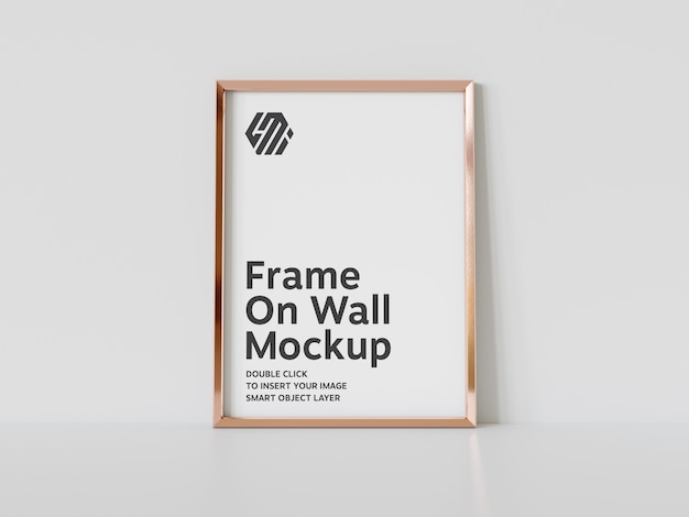 Vertical golden frame leaning on floor mockup