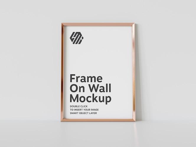 Vertical golden frame leaning on floor mockup