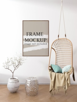 Vertical picture frame mockup on white wall