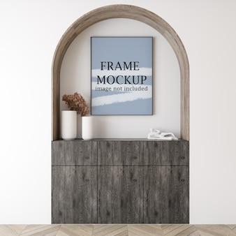 Vertical picture frame mockup above wooden cabinet