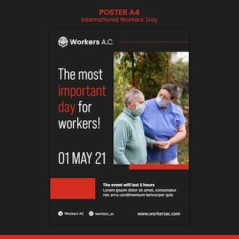 国際労働者の日のお祝いのための垂直ポスターテンプレート