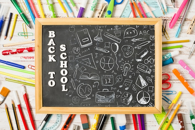 Above view blackboard on colourful pens