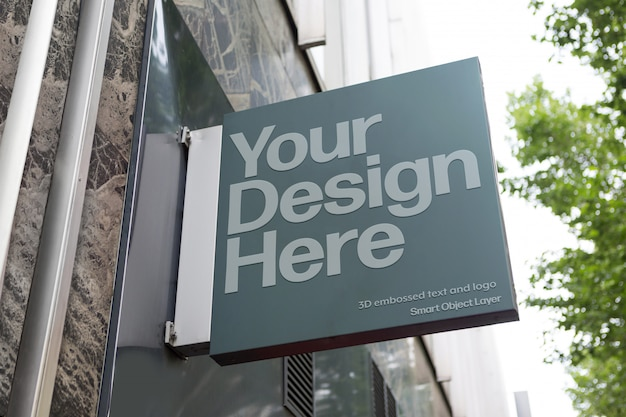 View of a building sign on street mockup