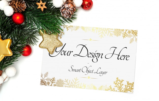 View of a holiday card and decorations mockup