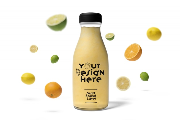 View of a juice bottle with fruit mockup