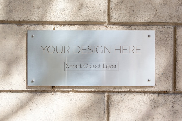 View of a metal sign on wall mockup