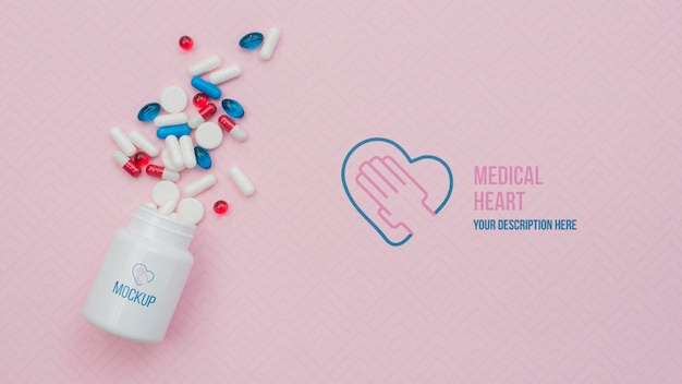 Above view pills with pink background Free Psd