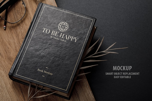 Vintage book cover mockup with dry leaves