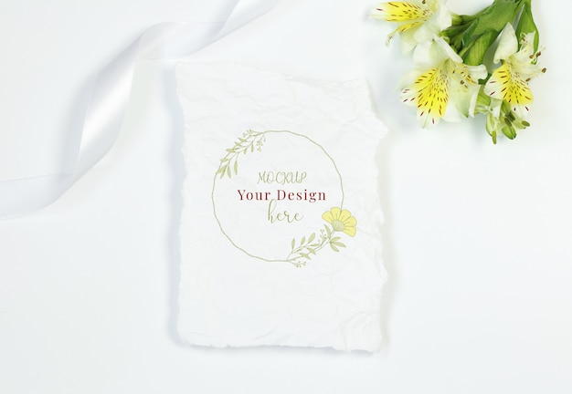 Vintage card with flowers and ribbon on white background