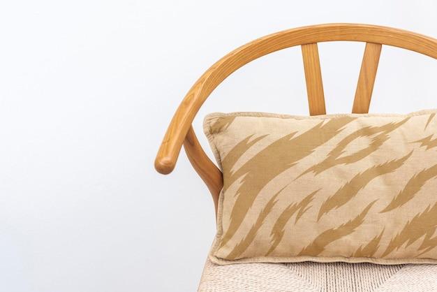 Vintage linen cushion cover mockup psd on an armchair