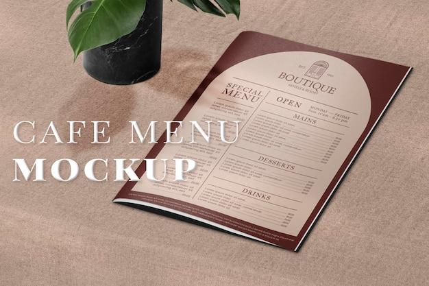 Vintage restaurant menu mockup psd on a table