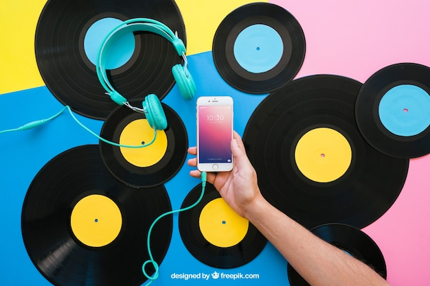 Vinyl mockup with hand holding smartphone
