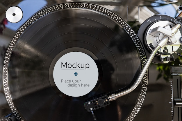 Vinyl record label mockup template. top view of the lp on the black turntable ready to use