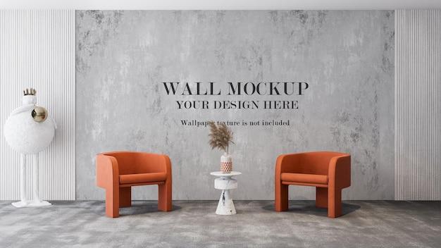 Waiting room wall mockup behind orange armchairs